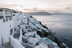 Famous white buildings of Oia town in Santorini. View of famous white buildings of Oia town on cliff in Santorini, Greece Royalty Free Stock Image