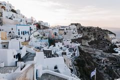 Famous white buildings of Oia town in Santorini. View of famous white buildings of Oia town on cliff in Santorini, Greece Royalty Free Stock Photography