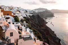 Famous white buildings of Oia town in Santorini. View of famous white buildings of Oia town on cliff in Santorini, Greece Stock Photo