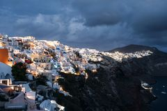 Famous white buildings of Oia town in Santorini. View of famous white buildings of Oia town on cliff in Santorini, Greece Royalty Free Stock Photos