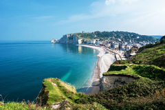 View from the famous white cliffs of Etretat on beach and village Royalty Free Stock Images