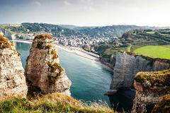 View from the famous white cliffs of Etretat on beach and village Royalty Free Stock Photography