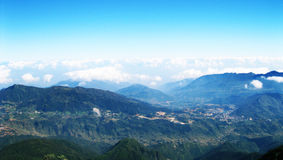View From Fansipan. I took this photo from Fansipan peak, Vietnam. I can see Sapa town among green moutains and lovely clouds Stock Images