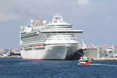 View of fantastic cruiseship Ventura docked in Alicante. Big cruiseship Ventura after a stop in Alicante harbor during a travel along the west Mediterranean Sea royalty free stock image