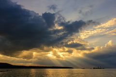 View of fantastic sky which has sunbeam and sand sucker boat in the sea ; Thailand. View of fantastic sky which has sunbeam and sand sucker boat in the sea Stock Photography