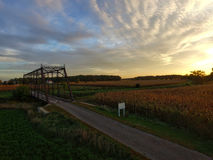 View of Farm Field and Bridge during Sunset Royalty Free Stock Image