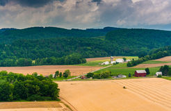 View of farm fields and distant mountains from a roadside overlo Royalty Free Stock Photography