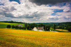 View of farm fields and rolling hills in rural Carroll County, M Stock Photo