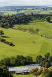 View of farm land and River Dove in Crowdecote Royalty Free Stock Image