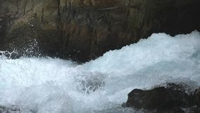 View on fast moving stream of mountain river. Powerful flood broking against stony surface splashing crystal clear water stock footage
