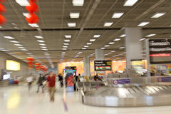Hustle Bustle Pace of Bangkok Airport Stock Image