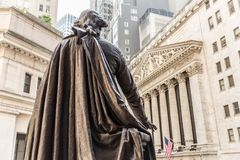 View from Federal Hall of the statue of George Washington and the Stock Exchange building in Wall Street, New York City. View from Federal Hall of the statue of royalty free stock photography