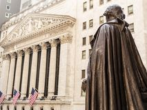View from Federal Hall of the statue of George Washington and the Stock Exchange building in Wall Street, New York City. View from Federal Hall of the statue of stock photography