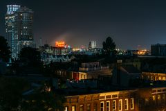View of Federal Hill and the Domino Sugars Factory at night in Baltimore, Maryland stock image