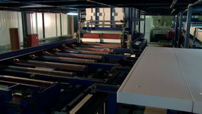 View of feeder moves finished sandwich panels