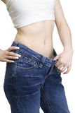 View of female became skinny and wearing old jeans Royalty Free Stock Photos