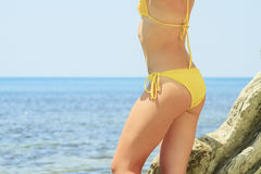 View of the female booty over blue sea Royalty Free Stock Photos