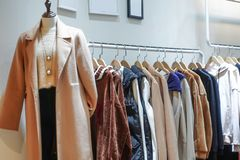Female winter clothing shop indoor royalty free stock photos