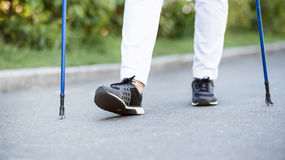 View of female legs while walking in park Stock Photo