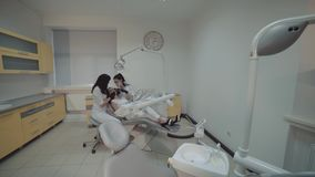 View of female teeth cleansing treatment in dental cabinet. 4K stock video