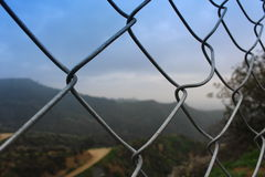 View from the fence. The view to The Griffith Park Observatory from the barbed wire along the hike to the Hollywood Sign Royalty Free Stock Photography