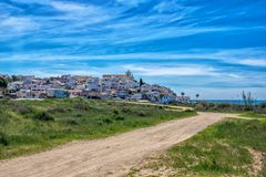 View on the Ferragudo, Lagoa, Algarve which the walkway in the foreground royalty free stock photography
