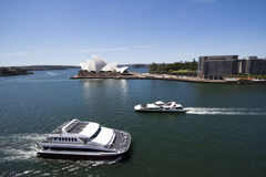 View at ferries in Sidney harbour with Opera house Stock Image
