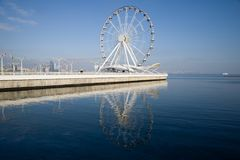 View of the Ferris wheel on the Caspian Sea embankment on a sunny December day. Baku, Azerbaijan royalty free stock images