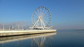 View of the Ferris wheel on the Caspian sea. Sunny January day timelapse. Baku, Azerbaijan. View of the Ferris wheel on the Caspian sea. Sunny January day stock video footage