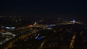 View of the Ferris wheel and the night city. From the Eiffel Tower stock footage