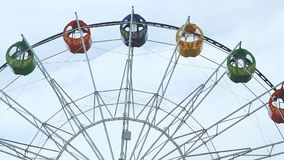 View of a ferris wheel over blue sky stock video