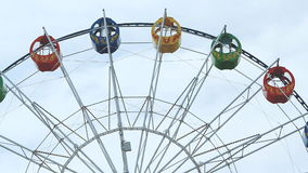 View of a ferris wheel over blue sky stock footage
