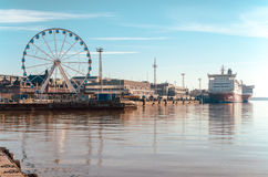 View of the Ferris wheel, the port and Viking ferry with beautiful reflection on the sea in Helsinki Finland Stock Photography