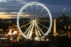A view of ferris wheel and some historic buildings in Paris royalty free stock photography