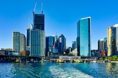 Sydney CBD and Circular Quay Ferry Terminal, NSW, Australia. View from ferry in Circular Quay to the ferry terminal and Sydney City CBD buildings, Sydney Harbour royalty free stock photo