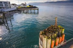 View From the Ferry Park on Mukilteo Terminal Right Before It Depart To Whidbey Island On A Beautiful Winter Sunny Morning. With the Mukilteo  lighthouse in the Royalty Free Stock Photo
