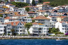 View from the ferry, which runs along the route Istanbul - Buyukada. Architecture and tourists on the island Kinaliada, Princes is. PRINCES ISLANDS, TURKEY royalty free stock image