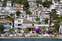 View from the ferry, which runs along the route Istanbul - Buyukada. Architecture and tourists on the island Kinaliada, Princes is. PRINCES ISLANDS, TURKEY stock photos