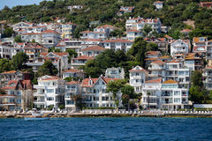 View from the ferry, which runs along the route Istanbul - Buyukada. Architecture and tourists on the island Kinaliada, Turkey. PRINCES ISLANDS, TURKEY - JULY 18 royalty free stock photography