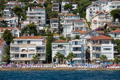 View from the ferry, which runs along the route Istanbul - Buyukada. Architecture and tourists on the island Kinaliada, Turkey Royalty Free Stock Photo