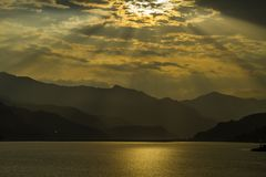 View on Fewa Lake and mountains in Pokhara, Nepal. View on Fewa Lake and mountains during sunset in Pokhara, Nepal royalty free stock photo