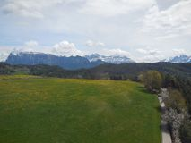 View of Field and Distant Alps in Italy Stock Photo