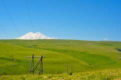 View of the fields and Mount Elbrus. View of the green fields and Mount Elbrus Stock Images