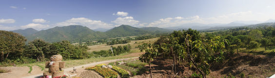 A view of fields and mountains in the village of Pai Royalty Free Stock Images