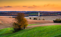 View of fields and rolling hills at sunset near Brogue, Pennsylv Royalty Free Stock Images