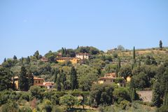 View of Fiesole, Italy. And houses surrounded by green trees royalty free stock images