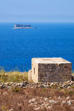 The view of Filfla islet with the guard building on the foregrou Stock Images