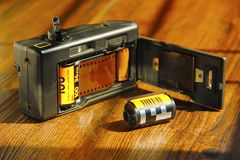 View of film camera with film roll inside. Close view of film camera with film roll inside Royalty Free Stock Photos