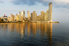 View of the financial district in Panama City, Panama. View of the financial district and sea in Panama City, Panama, at sunset Royalty Free Stock Image