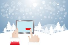 Finger of Santa Claus touching button Buy Now in winter landsca. View of finger of Santa Claus touching red button Buy Now in tablet.  Winter snowy  landscape is Royalty Free Stock Photography